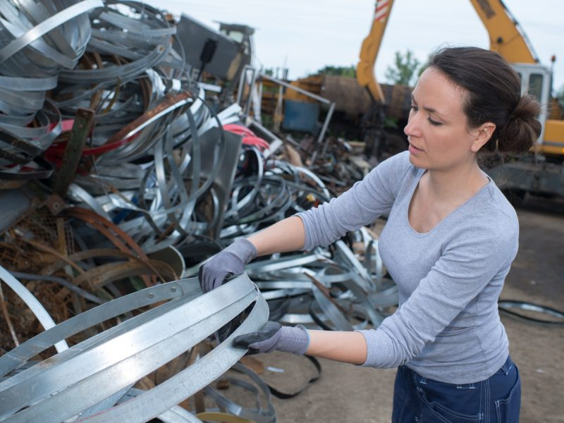 woman-at-a-junkyard-PQJ5PB7